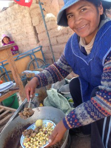 Dona Veri and her chicharon de llama.  A fried llama dish served  with local mote and chuno.